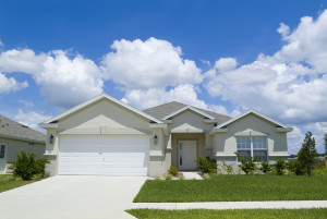 bigstock-Home-with-blue-sky-and-clouds--26404910